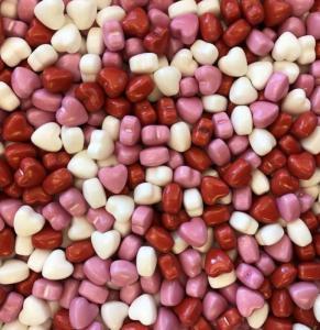 Themasnoep - gekleurde hartjes prijs is per 100 gram